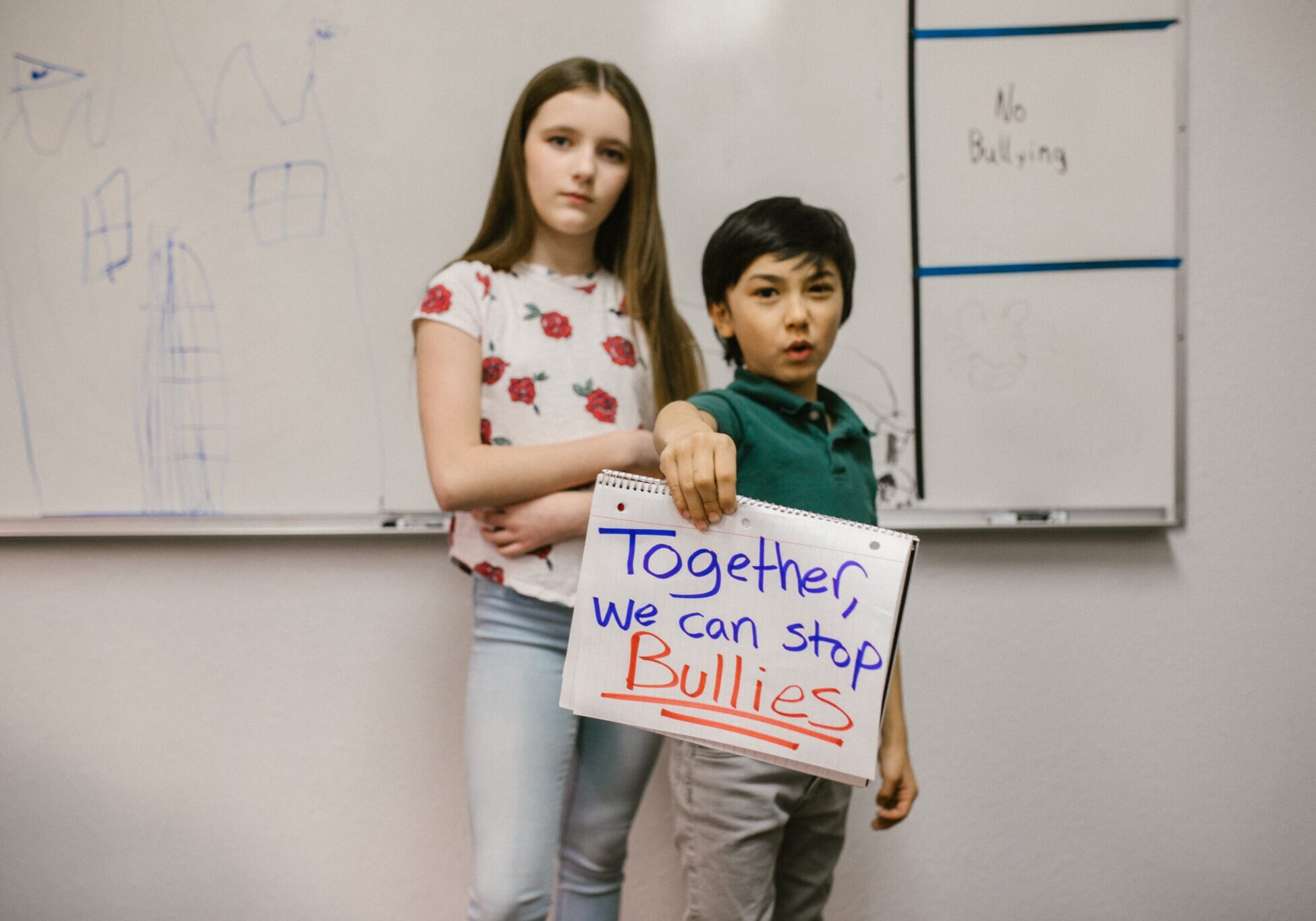 Children-holding-sign-together-we-can-stop-bullies